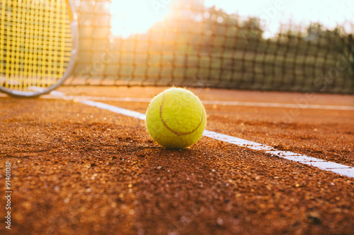 Plagát, Obraz Tennis racket and ball on a clay court