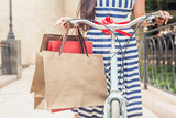 Fashion woman with bags and bike, shopping travel to Italy