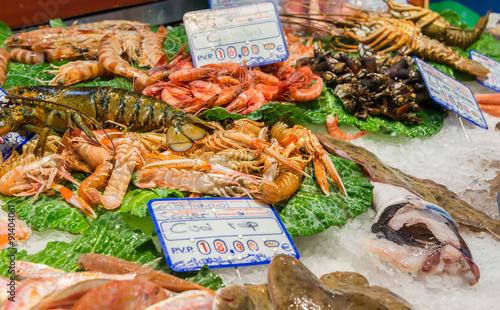 Fresh seafoods at the market La Boqueria in Barcelona. Spain