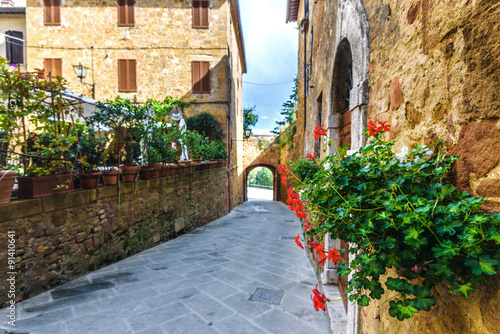 Street with flowers in the medieval Tuscan town.