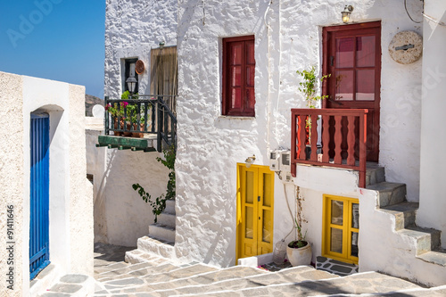 Scenic view of colorful street in traditional Greek cycladic vil