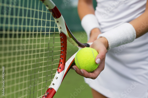Poster Tennis player holding racket and ball in hands