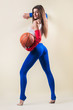 Sexy  Woman Holding Basketball In Hand On Yellow Background