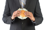 Concept for success and greed in business - Businessman holding a burger with dollar bills