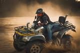 Fototapety Racing ATV is sand.