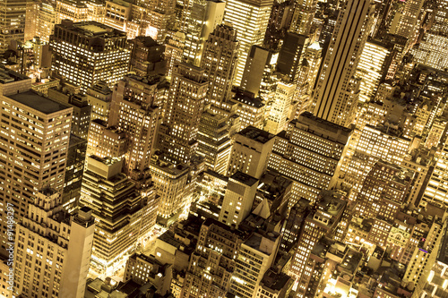 Fototapeta Golden cityscape of New York City buildings and lights at night