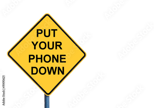 Poster Yellow roadsign with PUT YOUR PHONE DOWN message