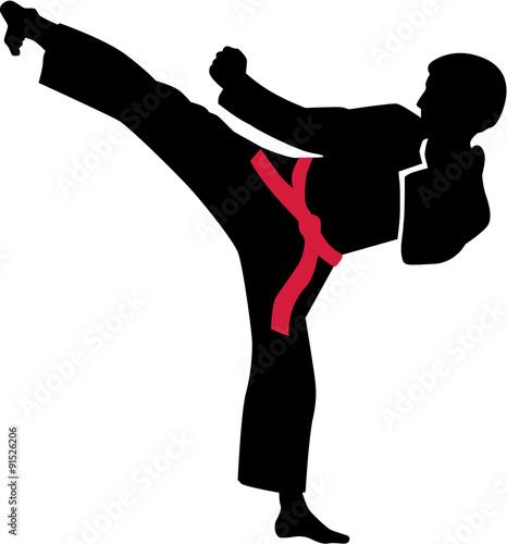 Fototapeta Karate kick with red belt