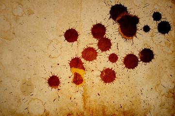 Red and black ink splattered on old paper. Useful for banner or logo.
