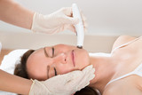 Woman Receiving Microdermabrasion Therapy poster