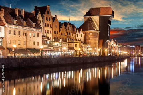 Fototapeta The riverside with the characteristic Crane of Gdansk, Poland.
