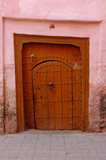 Old wooden door leading to Riad in Medina of Marrakesh poster