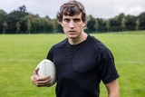Rugby player scowling at camera poster