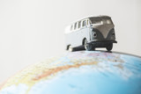 Vintage VW bus on globe