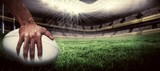 Fototapety Composite image of close-up of sports player holding ball