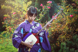 Japanese woman playing traditional shamisen