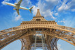 Airplane over Paris, France. Tourism and vacation concept