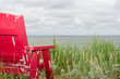 Red Adirondack at beach