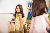 Hispanic little girl enjoying art class