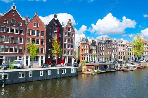 Traditional Amsterdam cityscape with apartment houses in down town. Netherlands.
