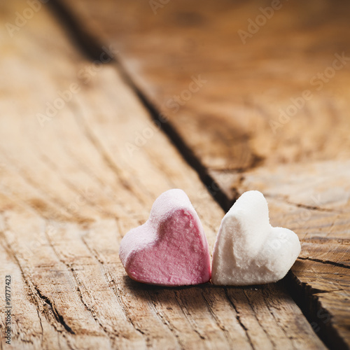 The pink and white heart on a wooden rustic table as background © Jarek Pawlak