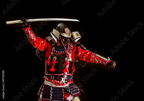 Samurai in ancient armor with a sword attack Poster