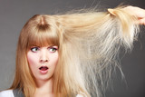 Fototapety Blonde woman with her damaged dry hair.