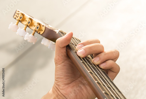 Fotobehang Muziek hand playing on guitar