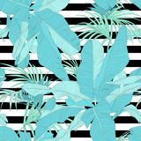 trendy tropical fabric seamless pattern, palm leaves on black and white stripes, vector illustration
