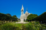 Jean XXIII Square, a park with a statue of Virgin Mary and the Christ child, is behind the Notre-Dame Cathedral on Ile Cite. - 91860423