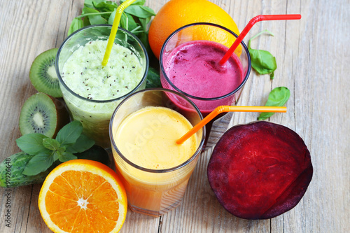 Fototapeta Fresh Detox Juices with Beet, Peaches, Spinach and Kiwi Fruit an