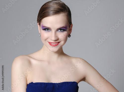 Aluminium Beautiful Brunette Girl. Luxury Makeup-gray background