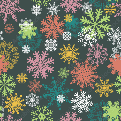 Materiał do szycia Seamless winter background with snowflakes. Colorful Christmas pattern.