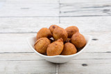 Popular Malaysian fritter snack deep fried banana balls or locally known as Cekodok Pisang in white bowl poster