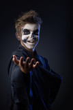 Teen with makeup skull showing indicates
