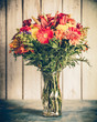 Lovely autumn bouquet of flowers with retro filter tone effect