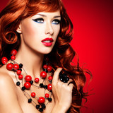 Fototapety Beautiful sexy woman with long red hairs and bright red lips.