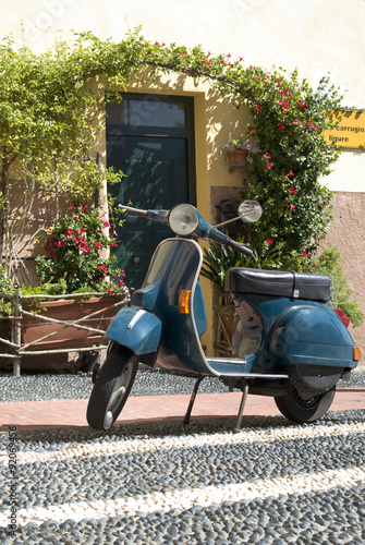Papiers peints Scooter Classic scooter parked in the street