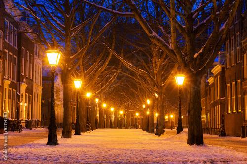 Poster Hooglandsekerkgracht in Leiden at twilight in winter with snow