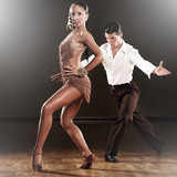 Fototapety latino dance couple in action - dancing wild samba in a ballroom with light sparcles
