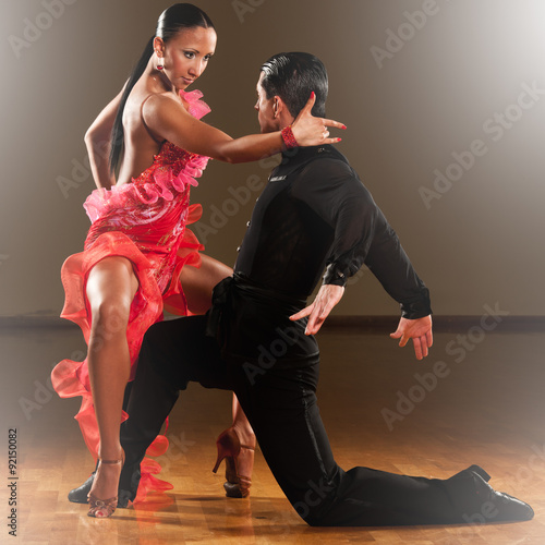 fototapeta na ścianę latino dance couple in action - dancing wild samba in a ballroom with light sparcles