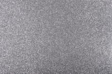 Silver background with metallic glitter texture in full frame