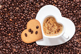 Fototapety Heart shaped cup and cookie on coffee beans background