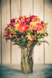 Autumn flower bouquet in vase with vintage tone filter effect