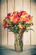 Obrazy na płótnie, fototapety, zdjęcia, fotoobrazy drukowane : Autumn flower bouquet in vase with vintage tone filter effect