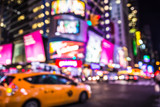 Fototapety Defocused blur of Times Square in New York City with lights at night and taxi cab