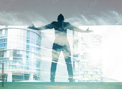 Double exposure of dancer silhouette in the city and cloudscape - 92193867