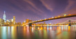 Long exposure of Brooklyn Bridge and downtown Manhattan skyline at night