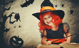 Fototapety Halloween. cheerful little witch with magic wand and book conjur