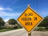 Road sign informing drivers of a blind person in the area